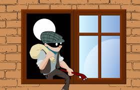 Burglar climbing out an open window